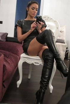 Wow what a photo nice long legs and long leather boots to match. Moody face bet she makes a great dominatrix