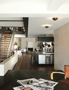 Modern open concept living - Kitchen - Contemporary architecture - Exposed brick