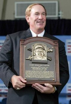 Gary Carter holds his plaque during induction ceremonies in Cooperstown, N.Y. Baseball Hall of Fame
