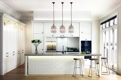 The supreme winner of the 2015 NZ House & Garden Interior of the Year awards is a beautiful Auckland kitchen that features painted pressed tin panels, including on the sliding panels that hide the hardworking laundry and larder areas. Best Kitchen Designs, Modern Kitchen Design, Interior Design Kitchen, Interior Ideas, Elegant Kitchens, Cool Kitchens, Beautiful Kitchens, Apartment Therapy, Layout Design