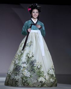 Emerald embroidered piece of art that is known as the Hanbok