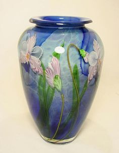 Tropic Orchid Vase by Mayauel Ward. An exquisite bouquet offlowers set inmultilayers of glass.