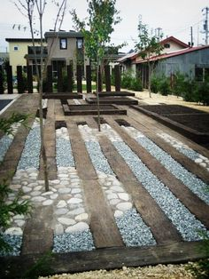 Don't like the trees planted in middle but interesting to space sleepers with stone. Cost of stone vs sleepers.probably wouldn't make this any cheaper than just sleepers? River Rock Landscaping, Railroad Ties Landscaping, Drought Resistant Landscaping, Gravel Patio, Sunken Garden, Le Far West, Yard Design, Back Gardens, Outdoor Areas