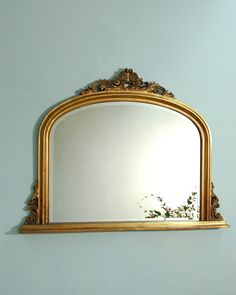 "Batemans - Mirrors, An overmantle mirror - simple, stylish and classical are words that perfectly describe this beautiful, antique gold mirror. The frame has decorative detail to the sides and is crested at the top with floral leaf design. Suitable for any traditional fireplace and a timeless ""Style Tool"" to dress your space."