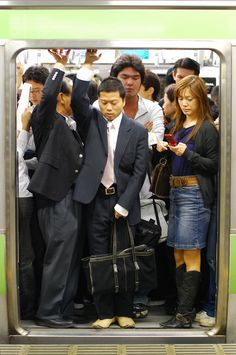 """Rush hour on the Yamanote line in Shinjuku Station, Tokyo, 2007 