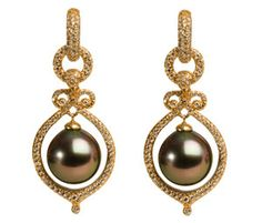Chocolate pearls dangle in a frame of antiqued yellow gold....