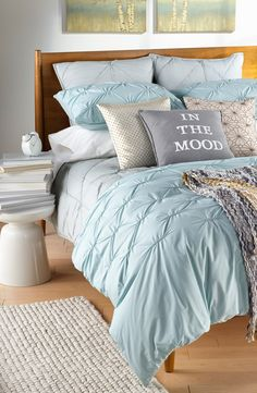 Love the pretty seaglass color of this bedding.