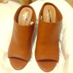 Tan Mules Open toe brown leather mules. Very good condition! Mossimo Supply Co. Shoes Mules & Clogs