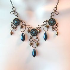 This lovely necklace makes good use of mixed media...a few upcycled slider beads, deep dark teardrop glass pearls, beautiful golden bronze freshwater