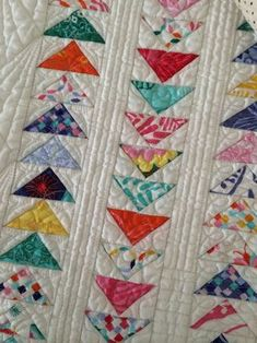 Love the straight line quilting in the sash of flying geese quilt