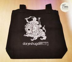 Black tote bag featuring a unique image of Dorje Shugden. This is specially designed for those who wish to bring Dorje Shugden's blessings with them wherever they go. It is also great as a gift. Unique Image, Black Tote Bag, Facebook Sign Up, Spirituality, Buddha Buddhism, Reusable Tote Bags, Marketing, Blessings, Zen