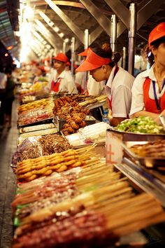 Dōnghuámén Night Market, Beijing (China). 'A sight in itself, the bustling night market is a veritable food zoo: lamb, beef and chicken skewers, corn on the cob, smelly dòufu (tofu), cicadas, grasshoppers, kidneys, quail eggs, snake, squid, fruit, porridge, fried pancakes, strawberry kebabs, bananas, Inner Mongolian cheese, stuffed eggplants, chicken hearts – and that's just the start. The vendors take great glee in persuading foreigners to try such delicacies as scorpion on a stick.'