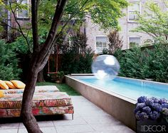 Fashion designer Cynthia Rowley  created a playful oasis in the backyard of her Manhattan townhouse, complete with a swing, chaise longues upholstered in cheerful prints, and a pool long enough for swimming laps or splashing around with her family.