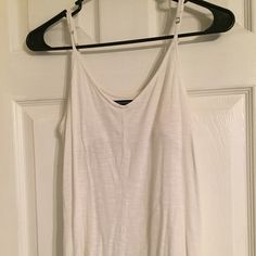 AE Strappy Tank Worn a few times, an off white color. Material is slightly see through unless also wearing an undershirt. Bra lining inside but no padding. Very soft and flowy. American Eagle Outfitters Tops