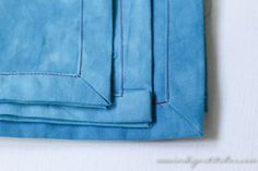 Learn how to miter your corners when sewing a double fold hem. Clean professional looking technique! Perfect for scarfs, napkins and table runners.