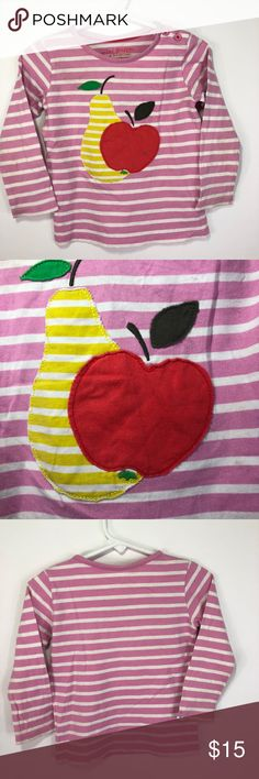 """Mini Boden Pink Stripe TShirt Pear Apple Applique Mini Boden Toddler girls size 1.5-2 (18 months - 2) Pink and white striped  Long Sleeve T-Shirt  Pear and Apple Applique  Armpit to armpit about: 11"""" across Length from shoulder to hem: about 14""""   Item has ever been put in dryer. Only laid flat to dry. One owner. Small pinhole on back of sleeve. Small blue dot on sleeve. Small dot on back of shirt. I never even noticed until photographing to list this. Please look at all photos. Thank you :)…"""