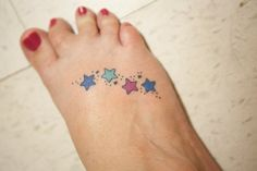 This is my foot tattoo, each star represents one of my four children - I love it!
