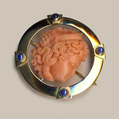 Coral Medusa in 18K gold Mount with Blue Sapphire Cabochons