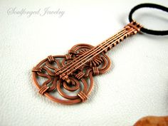 Hammered copper wire guitar pendant by SoulforgedJewelry on Etsy