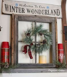 anchoring a christmas mantel with an old weathered window frame, christmas decorations, fireplaces mantels, seasonal holiday decor