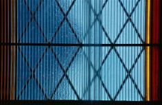 Spectral blue; window detail through winterizing panel; Chestnut Hill United Church, Philadelphia, Pennsylvania, USA.  September 2013.