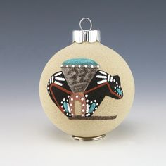 Fabulous Christmas ball ornament with sand painting of a medicine bear. 3  1/4″ tall x 2  1/2″ wide x 2  1/2″ long