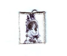 18th Century Woman Portrait Pendant by design mosaic. A fabric pendant. Embroidered around the edges with silver thread. The image is from an 18th century fashion plate. #handmade #jewelry #18thcentury #fashionplate
