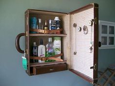 Vintage suitcase restyled as a medicine cabinet.