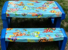 This is what the table looked like when I bought it except a little more faded. I got it from a yard sale and I hated the colors. Picnic Table Covers, Kids Picnic Table, Kid Table, Painted Picnic Tables, Plastic Picnic Tables, Painting Plastic Furniture, Outdoor Toys For Kids, Disney Fabric, Little Tykes