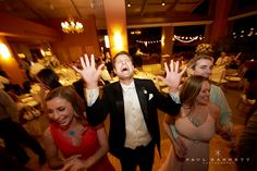 Great Candid shot of guests dancing and having a great time. Luxury Wedding Photography by photographer Paul Barnett.