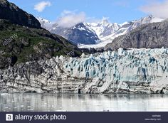 Download this stock image: Glacier and mountains of Glacier Bay National Park, Alaska, USA - HKPN9X from Alamy's library of millions of high resolution stock photos, illustrations and vectors.