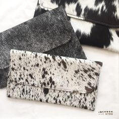 You can't get more unique than this trio. #cowhide #clutch #haironhide