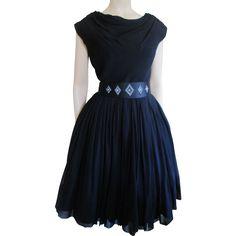 Black Swing Dress Vintage 1950s Miss Elliette Chiffon Beaded Belt Was $110 - Now $50 http://www.rubylane.com/item/676693-CLO55/Black-Swing-Dress-Vintage-1950s-Miss