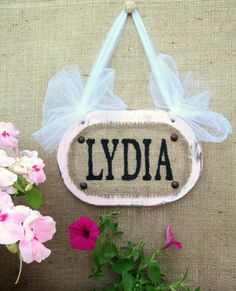 Personalized Pillow featuring the name LYDIA in photos of actual sign letters