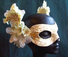 Who wouldn't be ready for a posh, surreal masquerade ball in this mask with flowers?