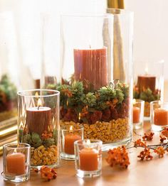 This fall candle arrangement is colorful and inexpensive. Simply layer dried corn, burgundy cockscomb celosia, pale-green dried hops, and brown oak leaves inside a wide cylinder vase. Then place a pillar candle in a narrower glass and center it.