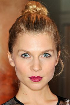 Clémence Poésy's top 10 looks: Sleek top knot with bold berry lips http://beautyeditor.ca/2014/03/26/clemence-poesy-hair-and-makeup/