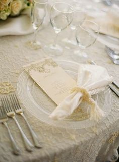Table scape - Ecru lace overlay linen, on off white damask  Pearl napkin ring  Beaded clear chargers