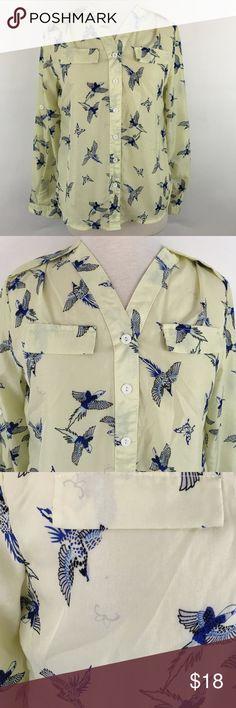 Birds & Butterflies Button Down Soft and silky shirt in a pale yellow with blue birds and butterflies. All tags are missing so brand and Size are unknown, but it fits like a small with a little wiggle room since there is no stretch. unknown Tops Button Down Shirts