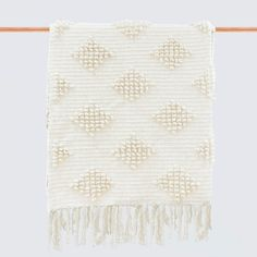 """Oversized Wool Bed Throw, handcrafted in Mexico by MexChic Design Studio, lays across end of a queen bed, boucle weave and soft cream hue, 100% sheep's wool, 70""""w x 96""""l, $395"""