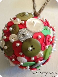 Take a styrofoam ball, buttons, and sewing pins. Stick the pins through the holes on the buttons, and then stick the buttons into the styrofoam. Make sure to fill the whole ball with buttons! Have fun!