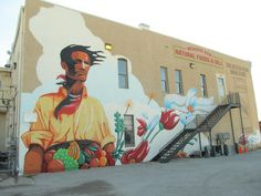 "Talal Cocker's ""Land and Liberty"" mural behind the Big Hollow Food Coop, Downtown Laramie, WY."