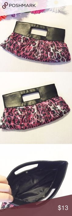 """Sparkly Fun Leopard Sequin Clutch This clutch is so fun and sassy, perfect for a night out! Pink and silver sequins in a leopard print. Measures 10.5"""" across, 7.25"""" Tall. Has one inside zipper pocket, and snap closure. Excellent condition! Bags Clutches & Wristlets"""
