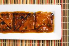 orange-chipotle glazed tofu. orange juice, maple syrup, rice vinegar, chipotle peppers (+ adobo sauce), salt + oil.