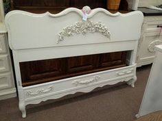 $199 - Queen size French headboard footboard and rails - It has been painted white and distressed with a hand applied garland. ***** In Booth H13 at Main Street Antique Mall 7260 E Main St (east of Power RD on MAIN STREET) Mesa Az 85207 **** Open 7 days a week 10:00AM-5:30PM **** Call for more information 480 924 1122 **** We Accept cash, debit, VISA, Mastercard, Discover or American Express