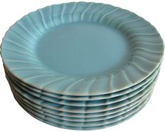 """Set of eight Gladding McBean swirl plates with a rich, glossy turquoise glaze. Marked: """"Franciscan Ware Made in California U."""