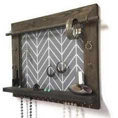 Wood Jewelry Organizer is made by us in our workshop. Our jewelry holders are made of solid wood and have a wire mesh to hold your dangle earrings, 20 hooks to hold your rings and necklaces, and a shelf to hold anything else. Rest assured you will be given a quality item that will