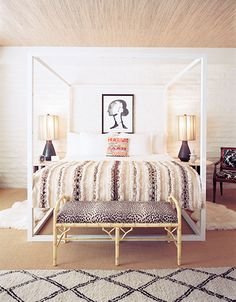 4-one-bed with Berber rug, Moroccan blanket, animal print and bamboo bench and grasscloth wallpaper on the ceiling.