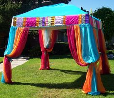 Fabric draped tent. I would paint the top part to be sure it was waterproof.