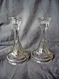"Offered for sale is this vintage pair of sterling silver overlay glass candlesticks. They measure 6-1/2"" high with a 3-3/4"" wide bases. They are in very good condition."